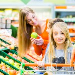 Family grocery shopping in hypermarket
